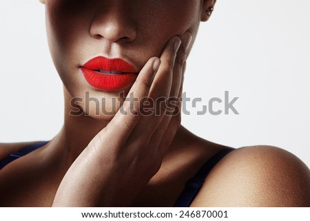 closeup of a woman's lips with a red matte lipstick - stock photo