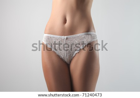 Closeup of a woman's waist wearing panties - stock photo