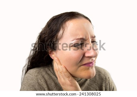 closeup of a woman with a severe ear pain with white background - stock photo