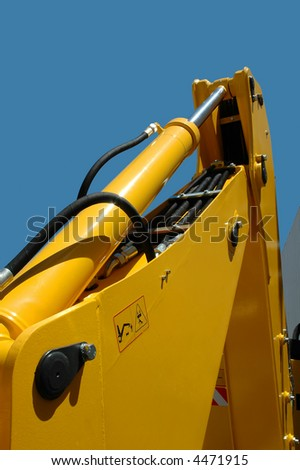 closeup of a working yellow multi purpose wheel-loader - stock photo