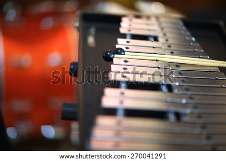 Closeup of a xylophone with percussion sticks - stock photo