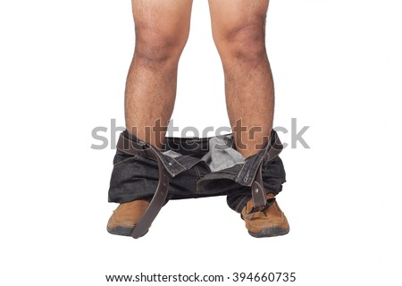 closeup of a young Asian man with his denim pants down, seen from front view on white background - stock photo