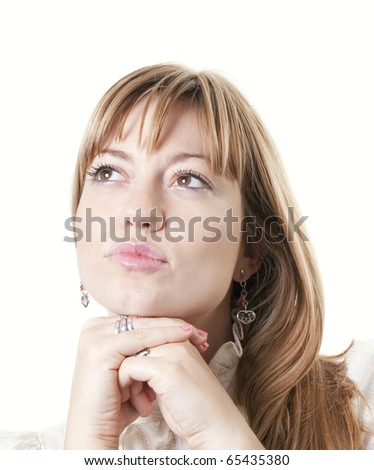 Closeup of a young attractive woman thinking - stock photo