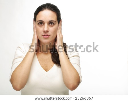 Closeup of a young beautiful woman frustrated and shutting her ears isolated over white background
