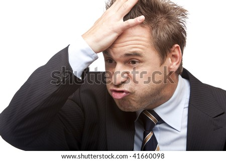 Closeup of a young businessman which forgot something important. Isolated on white. - stock photo
