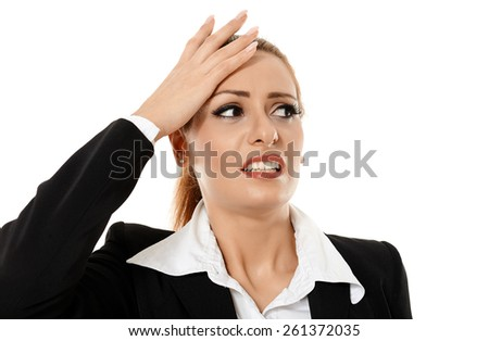 Closeup of a young businesswoman having a headache, isolated on white background - stock photo