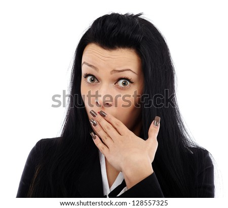 Closeup of a young businesswoman with an expression of shock, isolated on white background - stock photo