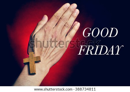 closeup of a young caucasian man praying with a wooden cross in his hands and the text good friday - stock photo