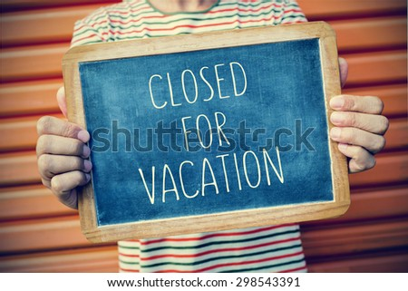 closeup of a young caucasian man showing a chalkboard with the text closed for vacation written in it, with a filter effect - stock photo