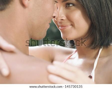 Closeup of a young couple face to face - stock photo