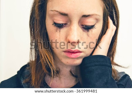Closeup of a Young girl,that is crying isolated on a white background - people and moods concept - stock photo