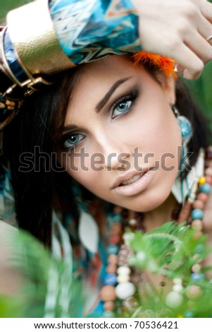 Closeup of a young girl with a huge golden bracelet on her arm - stock photo