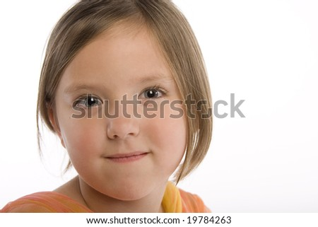 Closeup of a young round-faced girl isolated against white background