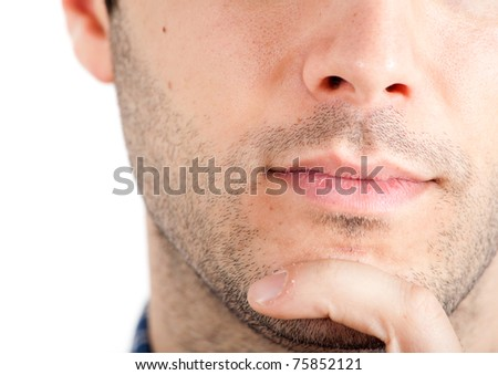 Closeup of a young thoughtful man's lips and chin - stock photo