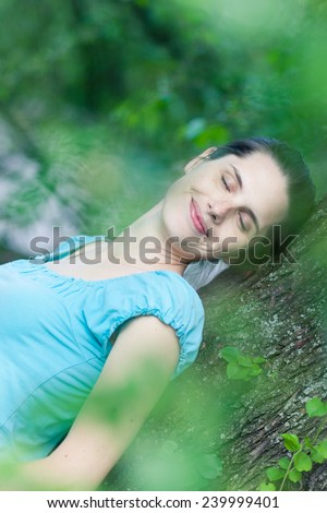 Closeup of a young woman day-dreaming - stock photo