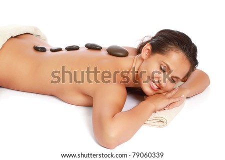 Closeup of a young woman getting spa treatment, isolated on white - stock photo