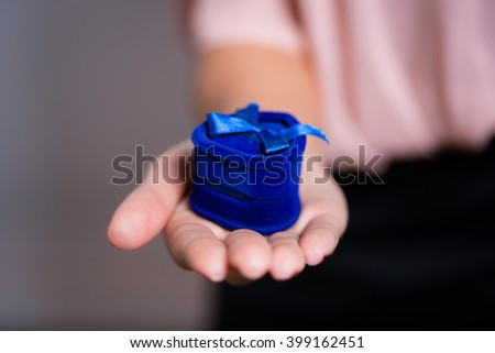 closeup of a young woman holding a ring Marry me - stock photo