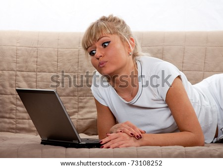 Closeup of a young woman using laptop at home