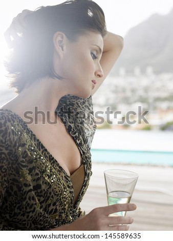 Closeup of a young woman with champagne glass outdoors - stock photo