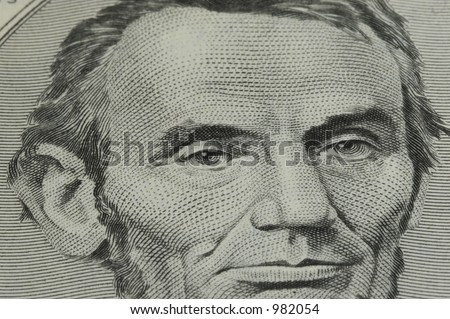 Closeup of Abraham Lincoln on Five Dollar Bill