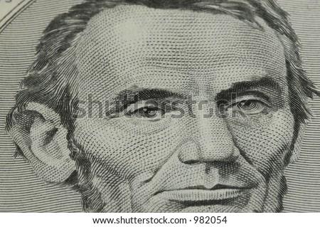 Closeup of Abraham Lincoln on Five Dollar Bill - stock photo