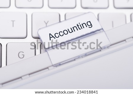 Closeup of Accounting tab attached to keyboard