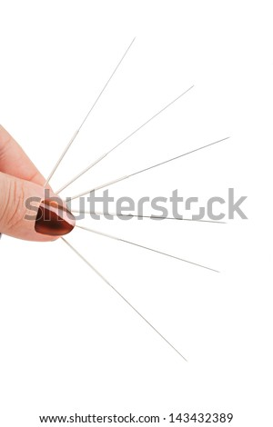 Closeup of acupuncture needle isolated on white background - stock photo