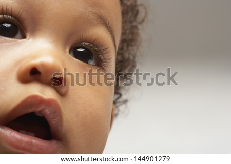 Closeup of African American curious baby boy looking away - stock photo