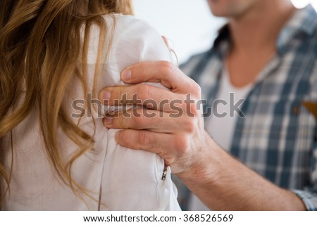 Closeup of aggressive man hand grabbed woman shoulder - stock photo