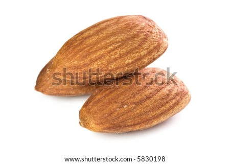 Closeup of almond nuts kernels isolated on white background. - stock photo