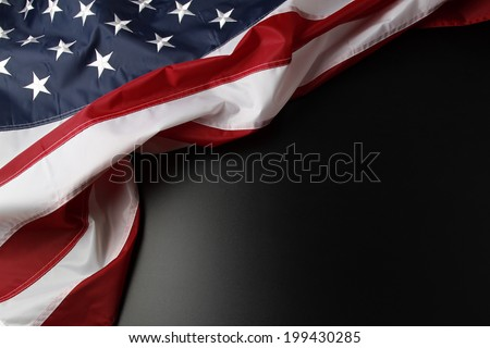 Closeup of American flag on dark background - stock photo
