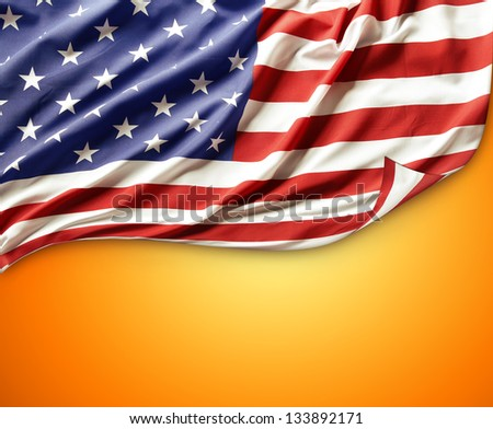 Closeup of American flag on orange background. Copy space - stock photo