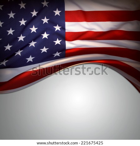 Closeup of American flag on plain background - stock photo