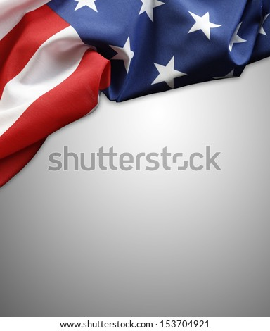 Closeup of American flag on plain background. Copy space - stock photo