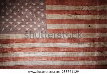 Closeup of American flag on wood - stock photo