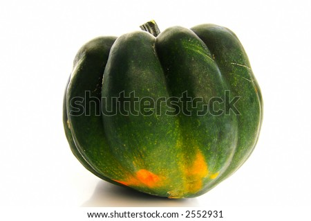 Closeup of an acorn squash on white