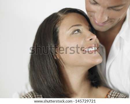 Closeup of an affectionate young man and woman - stock photo