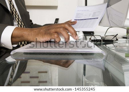 Closeup of an African American businessman using computer at his desk