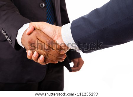 Closeup of an african and caucasian business man handshake - isolated on white - stock photo
