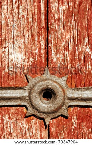 closeup of an ancient peeled wooden door - stock photo