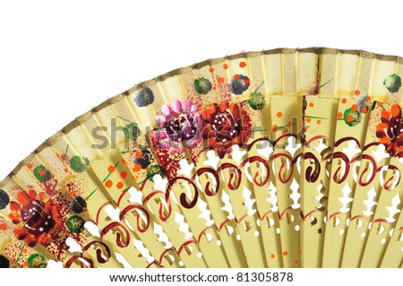 closeup of an ancient spanish hand fan on a white background - stock photo