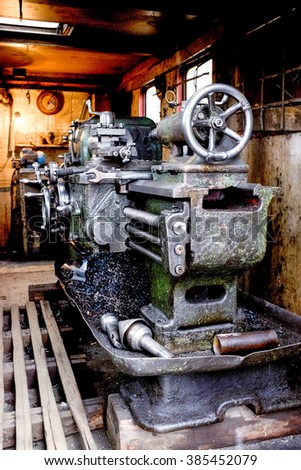 Closeup of an antique cast iron machinery - stock photo