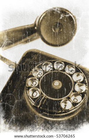 Closeup of an antique rotary telephone and a receiver (vintage style) - stock photo