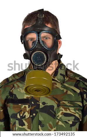 Closeup of an Army Soldier with Gas Mask - stock photo