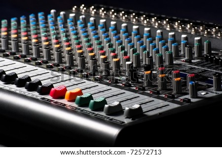 Closeup of an audio sound mixer - stock photo