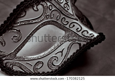closeup of an elegant carnival mask in black and white - stock photo