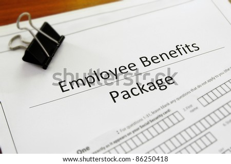 Closeup of an employee benefit package - stock photo