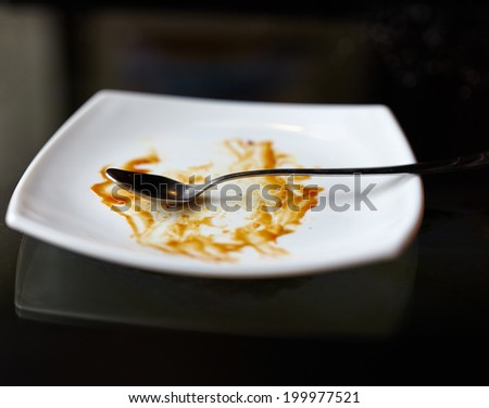 Closeup of an empty plate after the dessert was finished - stock photo