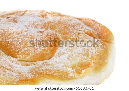 closeup of an ensaimada, a typical pastry of Mallorca, Spain - stock photo