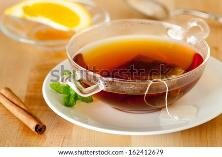 closeup of an herbal spice tea with mint, cinnamon and citrus